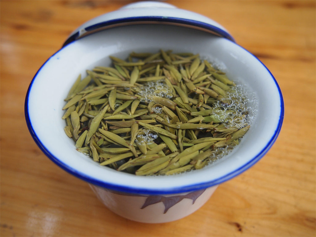 A teacup (gaiwan) with green tea